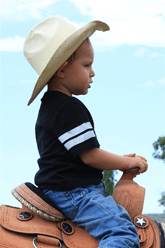 photo of boy on horse
