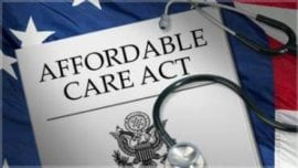 Affordable Care Act document and flag