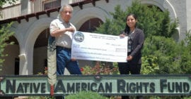 John Echohawk and Nadine Padilla with check from Siletz Grant