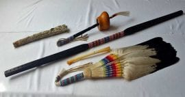 photo of sage, eagle feathers, other objects on table