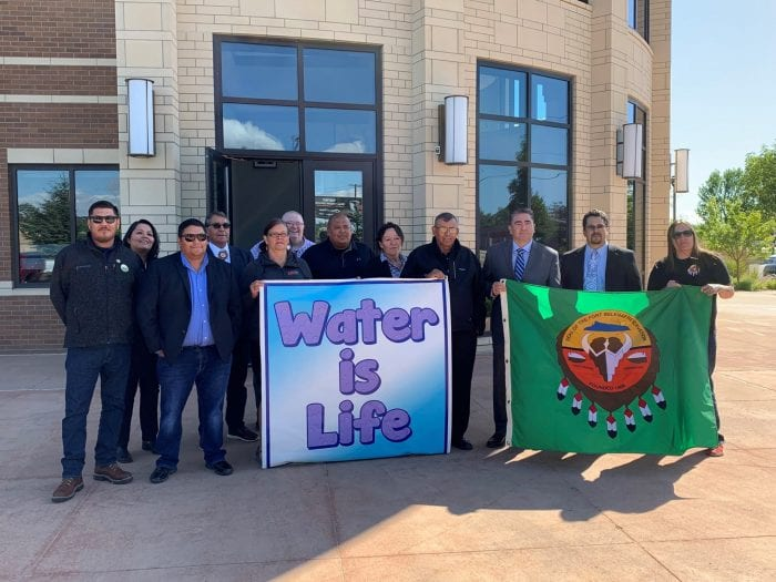 tribal supporters stand in front of the US District Court, September 2019
