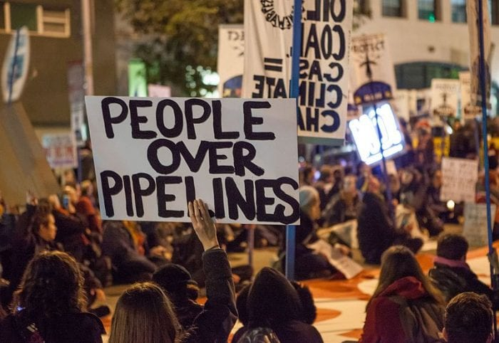 Protest sign: People Over Pipelines